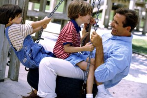 Man at park with his children