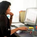 Woman reading computer monitor