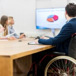 man in wheelchair at business meeting