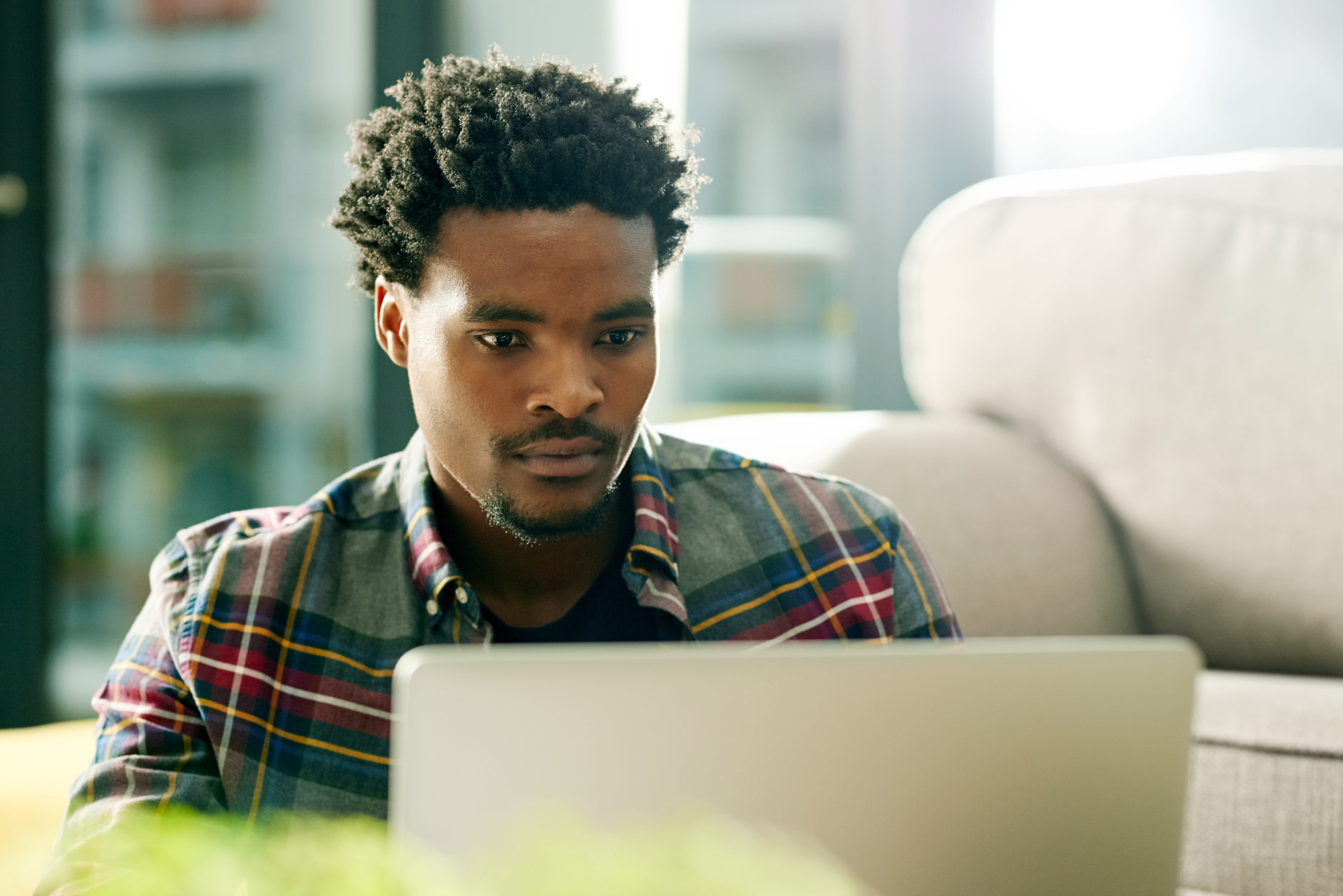 young african american man using computer