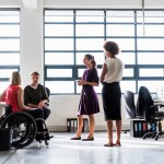 Workplace with employee in a wheelchair