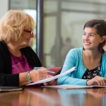 School counselor and student meeting
