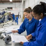 Women working on aircraft repair