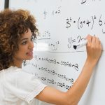 Female math student at whiteboard