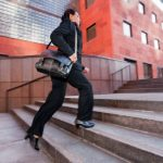 Business woman running up steps