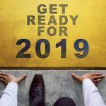 Man kneeling under words Get Ready For 2019