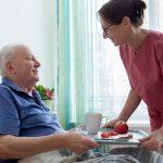healthcare worker assisting patient
