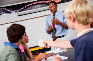 African American male teacher with students
