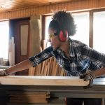 African american woman carpenter working