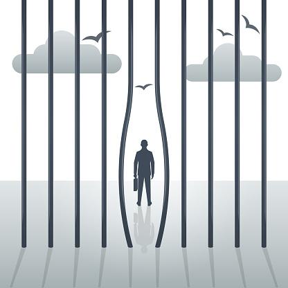 Freedom concept. The prisoner left the prison. Bending metal bars