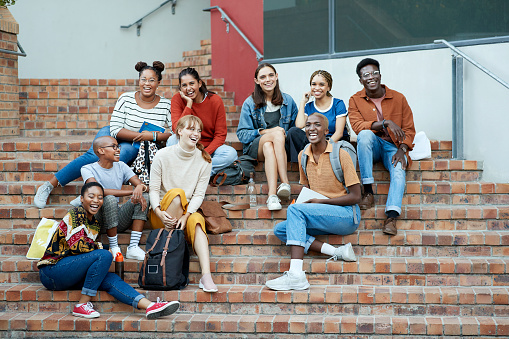 diverse college students gather on steps